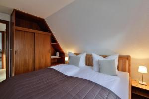 Ein Bett oder Betten in einem Zimmer der Unterkunft Auster-Appartements