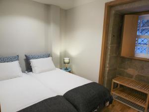 Een bed of bedden in een kamer bij Belomont6 Apartments