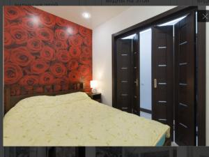 Кровать или кровати в номере Апартаменты на Виноградной 4