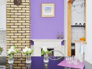 Reštaurácia alebo iné gastronomické zariadenie v ubytovaní Apartment T&M