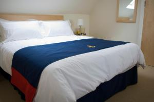 A bed or beds in a room at Royal Southern Yacht Club