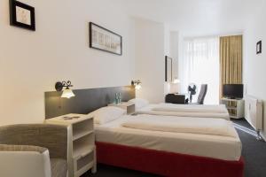 Ein Bett oder Betten in einem Zimmer der Unterkunft Aparthotel VEGA