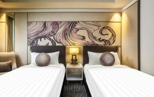 A bed or beds in a room at Amari Johor Bahru
