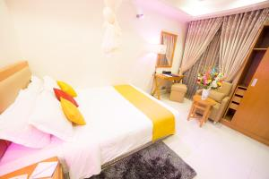A bed or beds in a room at Nascent Gardenia Luxury Suites