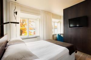 Säng eller sängar i ett rum på Hotel Skeppsholmen, a Member of Design Hotels™