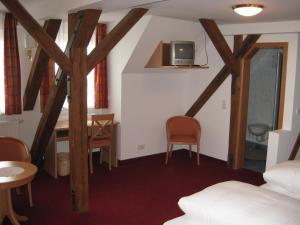 Ein Sitzbereich in der Unterkunft Gasthof Rössle