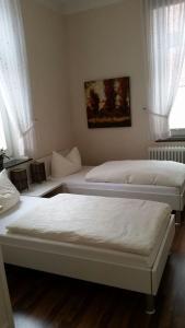 Ein Bett oder Betten in einem Zimmer der Unterkunft Gästehaus Villa Linda