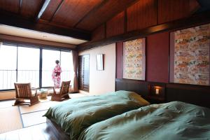 A bed or beds in a room at Kawazu Kaien