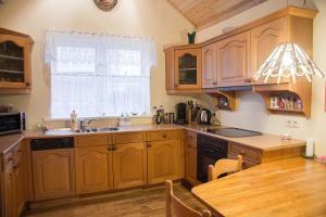 A kitchen or kitchenette at Hvammur Apartments