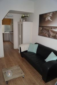 Coin salon dans l'établissement SteR Appartement Zandvoort