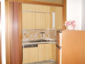 Cucina o angolo cottura di Condominio Portoro