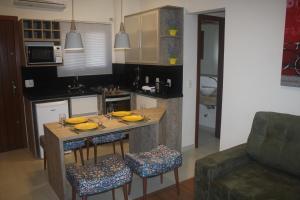 A cozinha ou cozinha compacta de Residencial Avenida