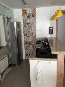 A cozinha ou cozinha compacta de Lindo Apto 2/4 em Guarajuba