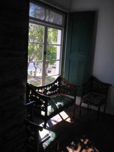 Uma área de estar em Hotel Pousada Hospedaria Antiga