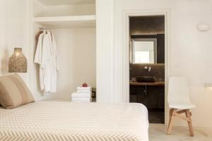 A bed or beds in a room at Naxian Collection