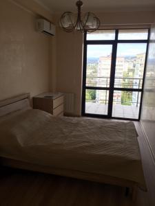 Кровать или кровати в номере Апартаменты на Политехнической 62