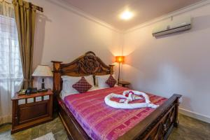 A bed or beds in a room at Delux Villa