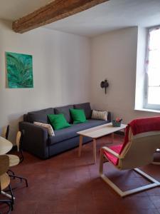 Coin salon dans l'établissement Appartements Cote pont Vieux-Self Check-In