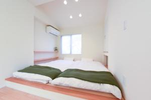 A bed or beds in a room at Luxury New House