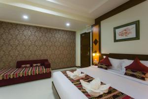 Cama o camas de una habitación en Mhonsa Hotel