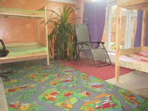A bed or beds in a room at Pershyy Hostel u Cherkasah