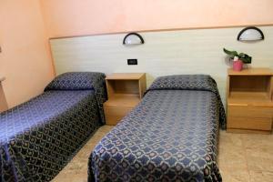A bed or beds in a room at Affittacamere La Noce