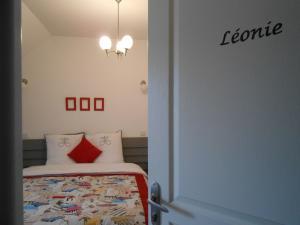 A bed or beds in a room at La Ferme du bois Paris