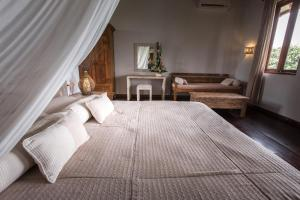 A bed or beds in a room at Ecosfera Hotel, Yoga & Spa