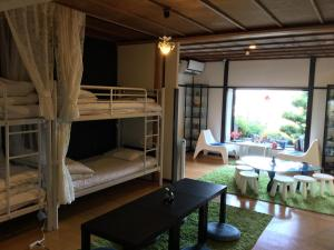 A bunk bed or bunk beds in a room at Bamboo Village Guest House