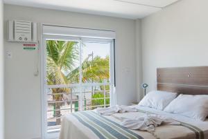Cama o camas de una habitación en Pousada Holiday