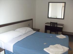 Letto o letti in una camera di Euro Inn B&B
