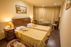 Кровать или кровати в номере Гостиница Валенсия