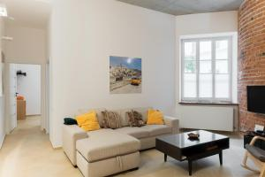 Część wypoczynkowa w obiekcie Apartment In the Heart of Warsaw