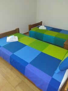 A bed or beds in a room at Zé da Rita Apartment