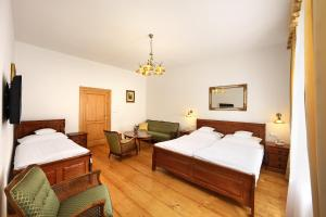 A bed or beds in a room at Pension Rozmarýna