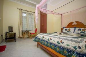 A bed or beds in a room at Ntungamo Resort Hotel