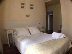 A bed or beds in a room at Pension Anne