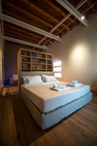 A bed or beds in a room at Massimago Wine Suites