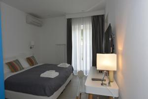 Letto o letti in una camera di Villa Catona Trigoria