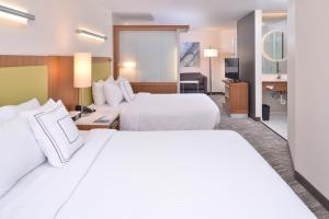 A bed or beds in a room at SpringHill Suites Las Vegas Henderson