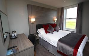 A bed or beds in a room at Leasowe Castle Hotel
