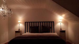 A bed or beds in a room at Lillehammer SPA Apartments