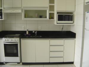 Una cocina o zona de cocina en Apartamento em Praia dos Ingleses