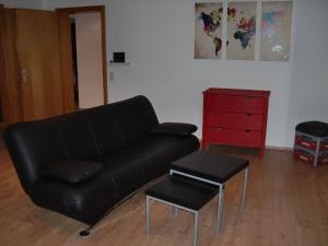 Ein Sitzbereich in der Unterkunft Ferienwohnung Super-Bude Ulmtal