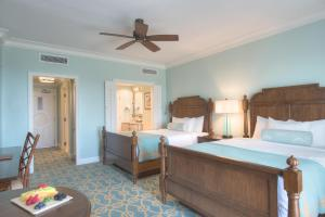 A bed or beds in a room at Henderson Beach Resort