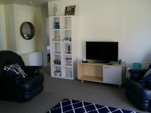 A television and/or entertainment center at Kea Cottage