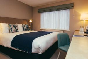 A bed or beds in a room at Peter Scott House Birmingham