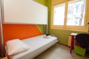 A bed or beds in a room at Residencia Albergue Studio