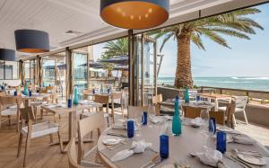 A restaurant or other place to eat at Strand Hotel Swakopmund
