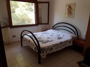 Letto o letti in una camera di Casa Giovanna
